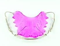 Close up of purple dental braces stock photo