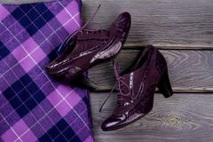 Close up purple shiny heel shoes. stock photo