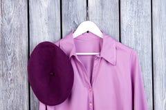 Close up purple shirt and hat, flatlay. stock photos