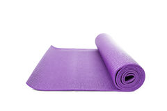 Close up purple yoga mat for exercise isolated Stock Image
