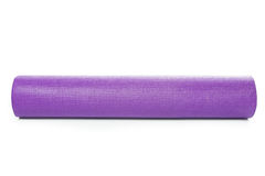 Close up purple yoga mat for exercise isolated Stock Photos