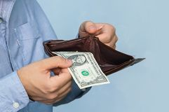 Close-up purse with dollars in their hands business man royalty free stock image