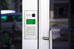 Close-up push-button lock of entrance doors royalty free stock photography