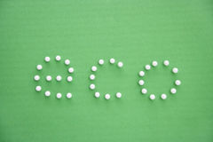 Close-up of push pins spelling eco over green background Stock Photography