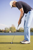 Close up of a putting golf player. Royalty Free Stock Images