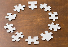 Close up of puzzle pieces on wooden surface. Business and connection concept - close up of puzzle pieces on wooden surface Stock Photography
