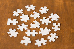 Close up of puzzle pieces on wooden surface. Business and connection concept - close up of puzzle pieces on wooden surface Stock Image