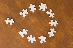 Close up of puzzle pieces on wooden surface. Business and connection concept - close up of puzzle pieces on wooden surface Stock Photo