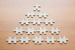 Close up of puzzle pieces on wooden surface Stock Photo