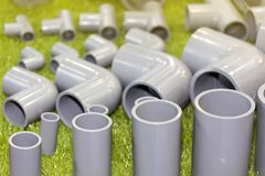 Close up pvc connector parts pipe elbow three way for plumbing work stock photos