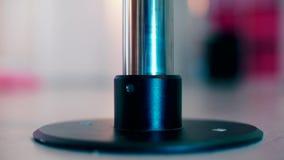 Closeup of a pylon base in a static glass.