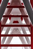 Pylon, red and white painted steel tower. The fragments showing the details of construction, joins, rivets. Close up of pylon construction. The red and white royalty free stock photos