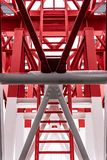 Pylon, red and white painted steel tower. The fragments showing the details of construction, joins, rivets. Close up of pylon construction. The red and white royalty free stock image