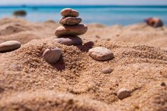 Close-up of a pyramid of stones laid on a sea beach.  stock images