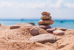 Close-up of a pyramid of stones laid on a sea beach.  royalty free stock images