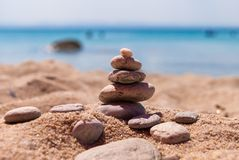 Close-up of a pyramid of stones laid on a sea beach.  royalty free stock photo