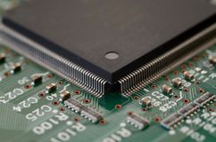Close up Quad Flat Pack on PCB Stock Image
