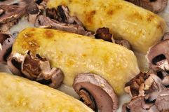 Quenelles au gratin with mushrooms stock image