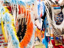 Close Up of Quill and Orange, Blue and Yellow Feather Bustle at Pow Wow. Close up of orange and black quill and blue, yellow and orange feathered bustle worn by royalty free stock photography