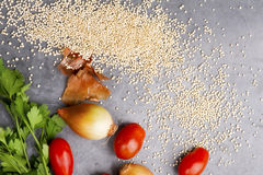 Close up of quinoa grains cherry tomato, onion and parsley Royalty Free Stock Images