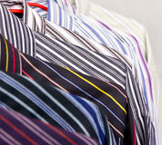 Close-up rack colorful shirts Stock Photos