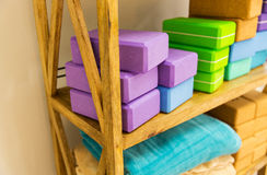 Close up of rack with yoga foam blocks and plaids Stock Photography