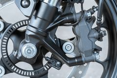 Close up of radial mount caliper on Motorcycle - disk brake and ABS system on a Sport Bikes. Close up of radial mount caliper on Motorcycle - disk brake and ABS royalty free stock images