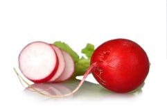 Close up of radish and radish slices isolated on white Stock Photos