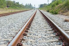 Close up rail joint, rail anchor with perspective line from railroad tracks. Safety transportation. Avoid traffic jam. Close up rail joint, rail anchor with stock image