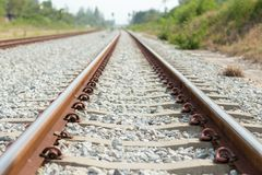 Close up rail joint, rail anchor with perspective line from railroad  tracks. Safety transportation. Avoid traffic jam. Public transportation for reduce green royalty free stock images