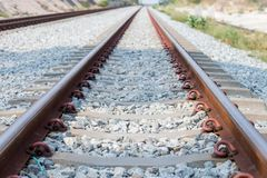 Close up rail joint, rail anchor with perspective line from railroad  tracks. Safety transportation. Avoid traffic jam. Public transportation for reduce green stock image