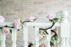 Close-up of railing staircase covered with artificial rose and ivy royalty free stock photography