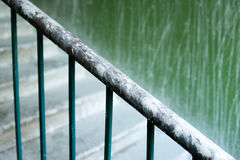 Close up of a railing on the stairs. Stock Images