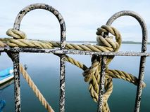 Close up railings. Railings rope tied sea harbour safety Stock Photography