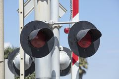 Close up of a railroad crossing light and barrier Royalty Free Stock Image