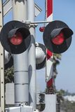 Close up of a railroad crossing light and barrier Stock Photography
