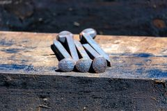 Close up of railroad spikes on wooden sleeper stock photography