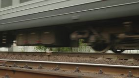 Close up of rails and train moving on. Slow motion stock footage