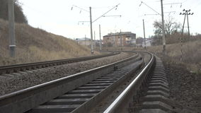 Close up railway track, houses in the Ukrainian village, 4K stock video footage