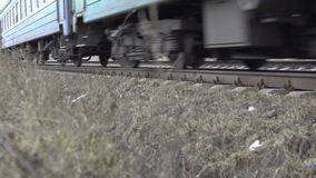 Close up railway, train moving on railway track in the field, bottom of train stock footage
