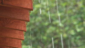 Close up of rain dripping off a roof stock video footage