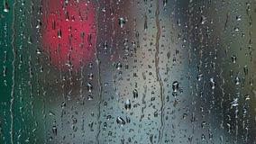 Close-up of rain droplets falling on window. Rainy day. stock video