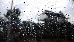Close up rain drops on glass, window view stock footage