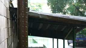 Close-up of rain falling. On and rolling off a roof and gutter on a house stock video
