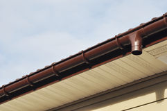 Close up on Rain Gutter Soffit Board, Fascia Board Installation. Rain Gutter Soffit Board, Fascia Board Installation Stock Photography