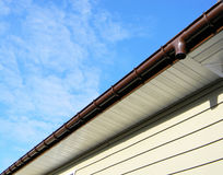 Close up on Rain Gutter Soffit Board, Fascia Board Installation. Against Blue Sky Royalty Free Stock Image