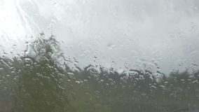 Close-up of the rain pouring on the window stock video