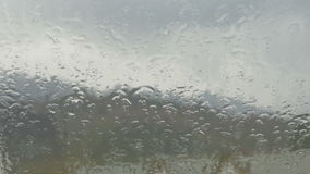 Close-up of the rain pouring on the window stock footage