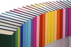 Close-up of rainbow-colored book arrangement