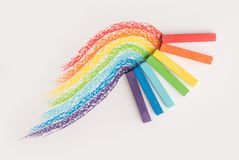 Close up of rainbow gradient made of pastel crayon chalks over t Royalty Free Stock Photos